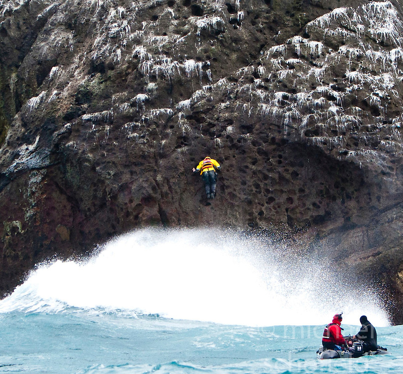 Nick Hancock (yellow dry suit), on the on the way down the face of Rockall, on his reconnaissance mission for a future 60 day occupation of Rockall, an extremely small, uninhabited, remote rocky islet in the North Atlantic Ocean. .The Rockall Jubilee Expedition, a unique endurance expedition to be undertaken by Nick, in order to raise funds for Help for Heroes.