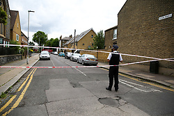 © Licensed to London News Pictures. 28/05/2019. London, UK. A police officer guards crime scene on Dyson Road, Forest Gate, East London where a man in his 30s died in the early hours of this morning following a flight on Warwick Road.<br /> Police officers were called after the victim was found suffering from stab injuries and he died later in the hospital. Photo credit: Dinendra Haria/LNP CAPTION UPDATED WITH CORRECT DATE