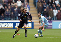 Photo: Leigh Quinnell.<br /> Coventry City v Leeds United. Coca Cola Championship. 18/03/2006. Leeds Shaun Derry leaves Coventrys Don Hutchison behind.