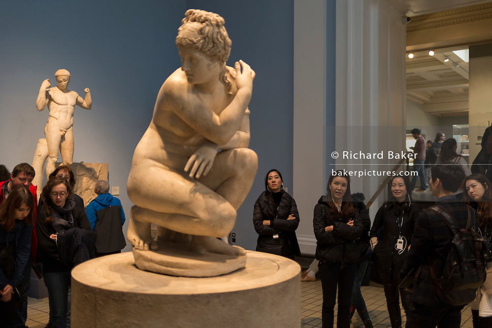 Women visitors admire the Hellenistic Crouching Aphrodite (Lely's Venus) sculpture, on 28th February 2017, in the British Museum, London, England.