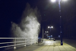 © Licensed to London News Pictures. 27/12/2013. Aberystwyth. UK.  High winds return to hit the West Wales town of Aberystwyth. Winds reaching 80mph have been whipping up the seas since early evening on Boxing Day.. Photo credit : Jon Freeman/LNP