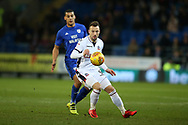 Adam Le Fondre of Bolton Wanderers gets to the ball ahead of Lee Peltier of Cardiff City. EFL Skybet championship match, Cardiff city v Bolton Wanderers at the Cardiff city Stadium in Cardiff, South Wales on Tuesday 13th February 2018.<br /> pic by Andrew Orchard, Andrew Orchard sports photography.