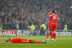 James Chester (Hull City) and Joe Ledley (Crystal Palace) celerate after Wales win the match 1-0 to top their UEFA2016 Qualifying Group - Photo mandatory by-line: Rogan Thomson/JMP - 07966 386802 - 12/06/2015 - SPORT - FOOTBALL - Cardiff, Wales - Cardiff City Stadium - Wales v Belgium - EURO 2016 Qualifier.