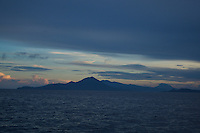 View of Volcanic peaks of Halmahera Island, North Moluccas, Indonesia from the sea.