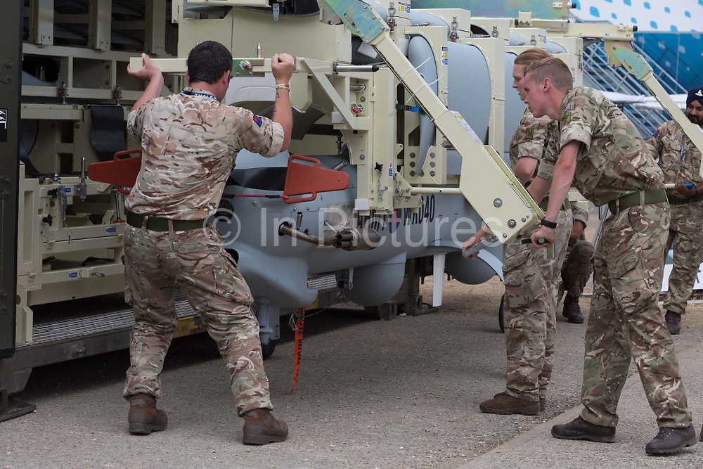 Members of British Armys Royal Artillery, demonstrate the rapid deployment of a Thales Watchkeeper UAV at the Farnborough Airshow, on 18th July 2018, in Farnborough, England.