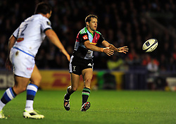 Nick Evans of Harlequins passes the ball- Photo mandatory by-line: Patrick Khachfe/JMP - Mobile: 07966 386802 17/10/2014 - SPORT - RUGBY UNION - London - Twickenham Stoop - Harlequins v Castres Olympique - European Rugby Champions Cup