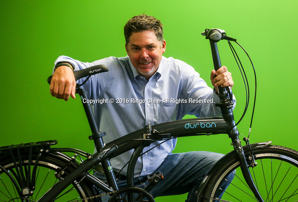 David White, managing director of Durban Bikes, with their folding bicycles.<br /> (Photo by Ringo Chiu/PHOTOFORMULA.com)<br /> <br /> Usage Notes: This content is intended for editorial use only. For other uses, additional clearances may be required.
