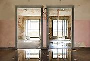abandoned building, view room fron the corridor, two doors
