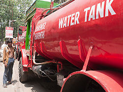 Tanker lorry supplying fresh drinking water, parked on Mumbai street.