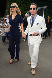 © Licensed to London News Pictures. 08/07/2016.  PHILLIPA COAN and JUDE LAW arrive for the twelfth day of the WIMBLEDON Lawn Tennis Championships. London, UK. Photo credit: Ray Tang/LNP