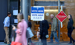 © Licensed to London News Pictures. 08/11/2016. New York CIty, USA. US voters arrive and depart a polling station in Manhattan, New York City on Tuesday, 8 November, the day of the presidential election in the United States of America. Photo credit: Tolga Akmen/LNP