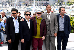 Gabriel Yared (left), Park Chan-Wook (second left), Pedro Almodovar (centre), Will Smith (second right) and Paolo Sorrentino (right) attending the Festival De Cannes Jury photocall as part of the 70th Cannes Film Festival. Photo credit should read: Doug Peters/EMPICS Entertainment