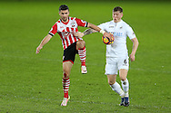 Shane Long of Southampton is challenged by Alfie Mawson of Swansea city (r).  Premier league match, Swansea city v Southampton at the Liberty Stadium in Swansea, South Wales on Tuesday 31st January 2017.<br /> pic by  Andrew Orchard, Andrew Orchard sports photography.