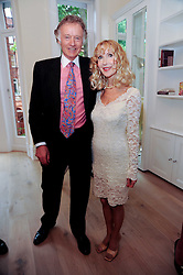 RICHARD & BASIA BRIGGS at a reception to celebrate the repairs on the Queen Elizabeth Gate in Hyde Park after it's successful repair following damaged sustained in a traffic accident in early 2010.  The party was held at 35 Sloane Gardens, London on 7th June 2010.