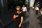 Pedestrians walking close to London Bridge, many using their mobile phones on 19th June 2017 in London, United Kingdom.  From the series Our Small World, an observation of our mobile phone obsessions