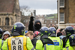 © Licensed to London News Pictures . 30/01/2016 . Dover , UK . Far right protesters do Nazi salutes at the demonstration . Demonstrations by far-right groups (including The National Front , The North West Infidels and The South East Alliance ) and , opposing them , anti-fascists , close to the port of Dover in Kent . Photo credit : Joel Goodman/LNP