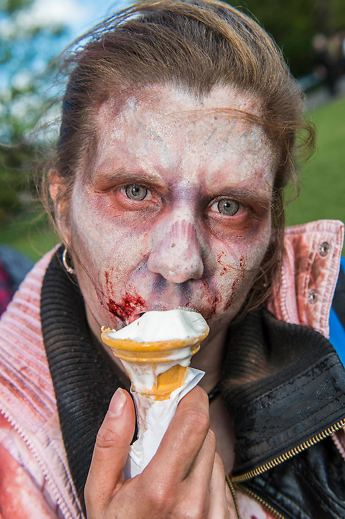 Zombies roaming the streets of London. The zombies have been designed by Hollywood make-up artist Kristyan Mallett for the newly opened immersive theatre show The Generation of Z: Apocalypse. They travelled by tube and bus and a lot of walking to visit The London Eye, Buckingham Palace, Big Ben and Westminster to pull some frights on the unsuspecting public.