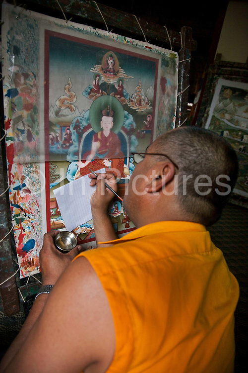 Traditional Nepalese painting in a gallery off the Bhaktapur Durbar Square. A painting can take up to 3 months to finish and often depicts religious symbols , gods and iconography, either Buddhist or Hindu.