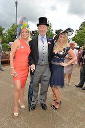 Left to right, CHRIS & JANICE WRIGHT and their daughter HOLLY WRIGHT at day one of the Royal Ascot 2016 Racing Festival at Ascot Racecourse, Berkshire on 14th June 2016.