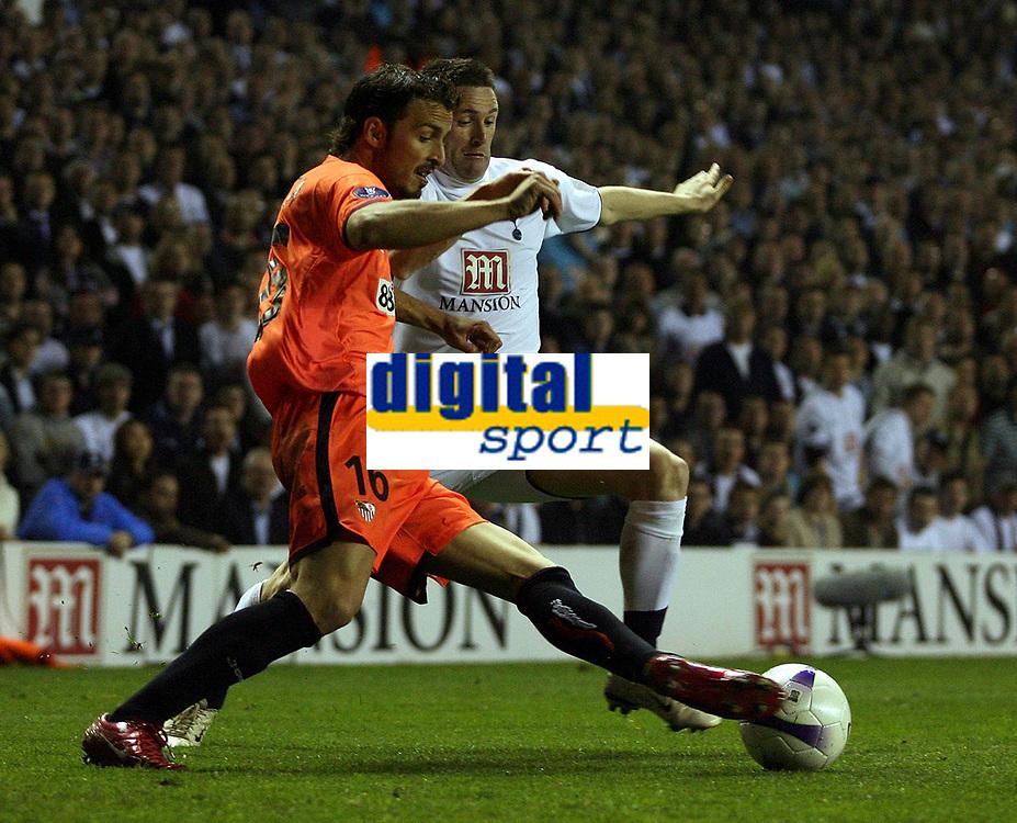 Photo: Paul Thomas.<br /> Tottenham Hotspur v Sevilla. UEFA Cup. Quarter Final, 2nd Leg. 12/04/2007.<br /> <br /> Robbie Keane (R) of Spurs tries to tackle Antonio Puerta.