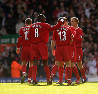 Photo. Glyn Thomas.<br /> Liverpool v Leeds Utd. Barclaycard Premiership.<br /> Anfield, Liverpool. 25/10/03.<br /> Liverpool players congratulate Danny Murphy after he scored his side's second goal from a direct free kick after Jermaine Pennant handballed.