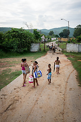 26 September 2015, Trinidad, Cuba: An old but functional commuter train runs through the countryside villages near Trinidad. Here, passengers have got off and are heading home.