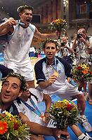 29/08/04 - ATHENS  - GREECE -  - BASKETBALL SEMIFINAL MATCH   - Indoor Olympic Stadium - <br />ARGENTINA win over ITALY and win the GOLD MEDAL<br />Argentine celebration after win the match.<br />Here left EMANUEL GINOBILI - Up WOLKOWISKY RUBEN - right PEPE SANCHEZ.<br />© Gabriel Piko / Argenpress.com / Piko-Press