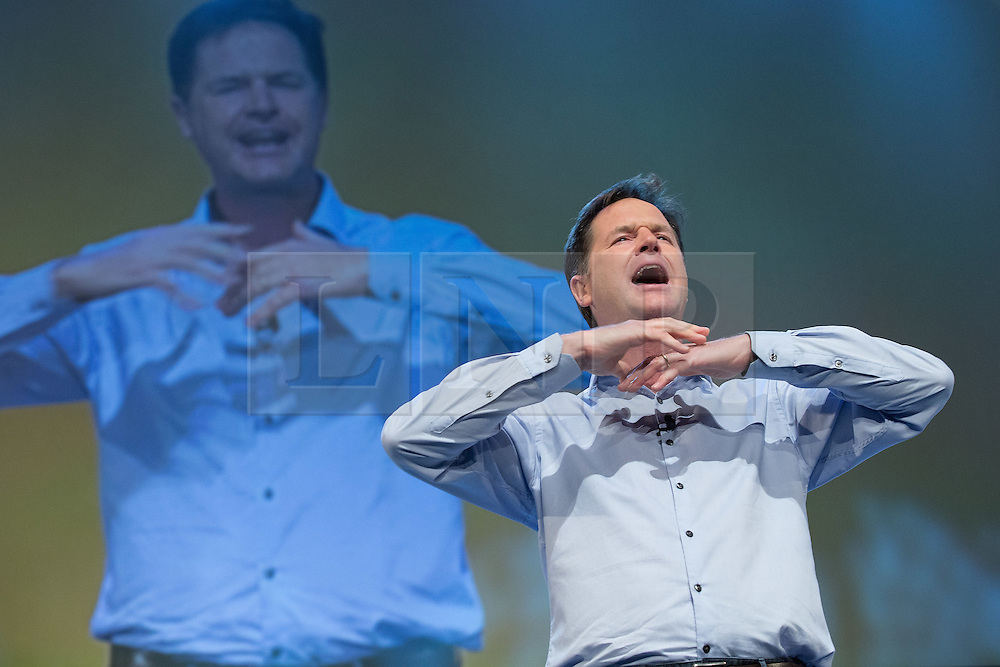 © Licensed to London News Pictures . 04/10/2014 . Glasgow , UK . NICK CLEGG addresses a party rally at The Liberal Democrat Party Conference 2014 at the Scottish Exhibition and Conference Centre in Glasgow . Photo credit : Joel Goodman/LNP