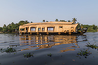 """The main mode of transportation in Kerala Backwaters has always been by kettuvalloms which means """"roof boat"""". They are usually made of wood joined  together with coconut ropes and painted with cashew oil outside. Many kettuvalloms have been converted to houseboats with  beds, kitchens and toilets."""