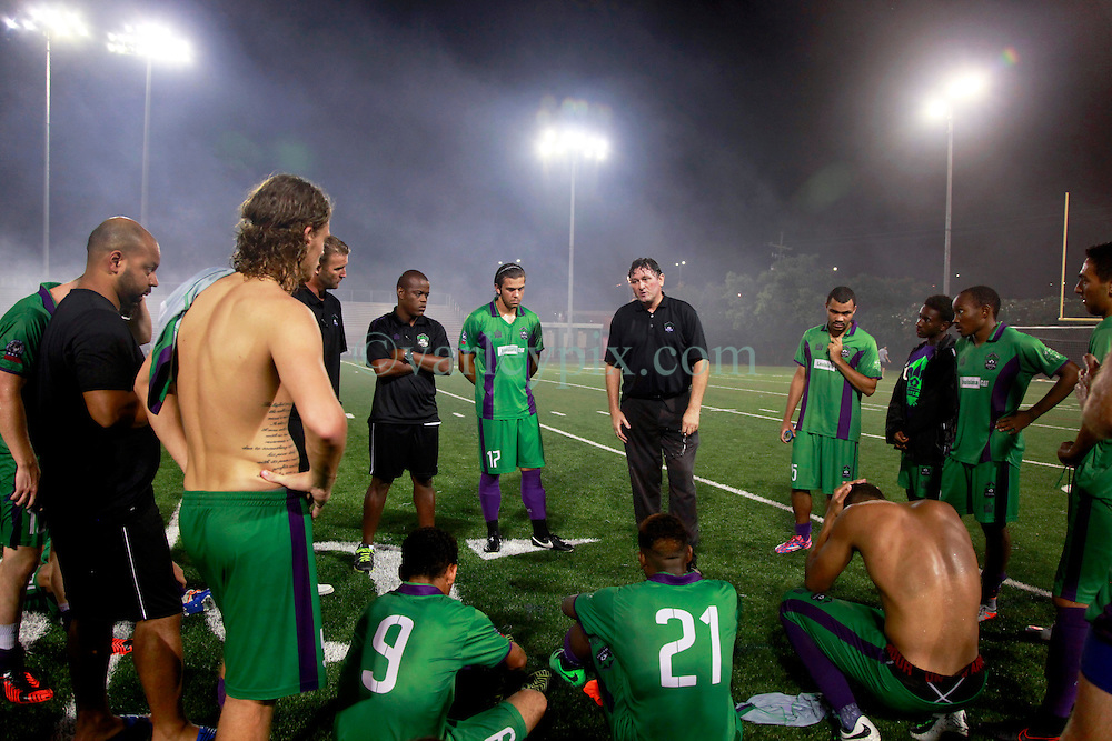 24 June 2015. New Orleans, Louisiana.<br /> National Premier Soccer League. NPSL. <br /> Jesters 0 - Atlanta Silverbacks 1.<br /> Head coach Kenny Farrell of the New Orleans Jesters  gives a team talk following a tough defeat.<br /> Photo©; Charlie Varley/varleypix.com