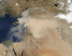 "Satellites often observe dust swirling over remote and unpopulated deserts but most of these events go largely unnoticed. Not so with the major dust storm that made international news in September 2015 for enveloping heavily-populated areas in the Middle East and North Africa.<br /> Dust first emerged in Moderate Resolution Imaging Spectroradiometer (MODIS) satellite imagery in Syria on September 6, 2015. By September 7 (top image), a thick plume swept across Syria, the Mafraq region of Jordan, and part of Turkey's Mediterranean coast. By September 8 (bottom image), dust had enveloped all of Lebanon, Israel, Jordan, Cyprus, and the Palestinian Territories. By September 9, it had moved southwest and spread over northeastern Egypt and the Gulf of Suez.<br /> The influx of dust triggered a rash of canceled flights, closed ports, and a suspension of daily activities for many people. In several countries, authorities are advising the elderly and young children to stay indoors. The number of people visiting hospitals with respiratory problems has increased significantly, and several deaths have been attributed to the dust, according to media reports.<br /> While satellites observe the dust from above, air quality sensors on the ground are recording remarkable amounts of particulate matter in surface air. In Jerusalem, pollution levels were 173 times higher than average, according to one news report. A sun photometer at the Sede Boker AERONET station in southern Israel showed a dramatic increase in aerosol optical depth (AOD) - a measure of how much sunlight is scattered by particles in the atmosphere.<br /> ""Satellite instruments, particularly MODIS, have revolutionized the scientific community's ability to understand the spatial extent, transport pathways, and the source areas of dust storms,"" explained Thomas Gill, an atmospheric scientist at the University of Texas at El Paso. ""Largely because of MODIS, we now have a much better understanding of what specific kinds of landforms and landscapes"