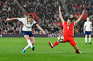 Abbie McManus (6) of England shoots at goal with Kayleigh Green (9) of Wales stetching to try and blocl the ball during the FIFA Women's World Cup UEFA Qualifier match between England Ladies and Wales Women at the St Mary's Stadium, Southampton, England on 6 April 2018. Picture by Graham Hunt.