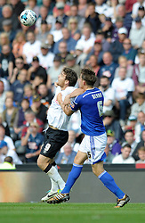 Derby County's Chris Martin and Ipswich Town's Christophe Berra challenge for the ball - Photo mandatory by-line: Dougie Allward/JMP - Mobile: 07966 386802 30/08/2014 - SPORT - FOOTBALL - Derby - iPro Stadium - Derby County v Ipswich Town - Sky Bet Championship