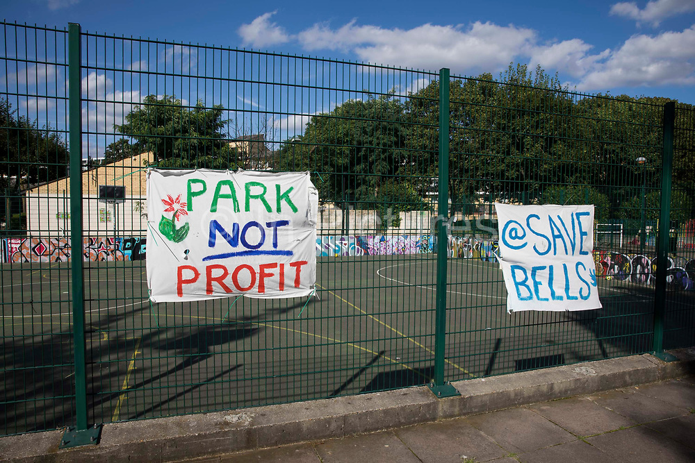 Banners prepared by local residents and campaigners are displayed on fencing around sports facilities at Bells Gardens in Peckham on 14th August 2021 in London, United Kingdom. Southwark Council proposes to build 97 new homes a mix of social and private housing, a reprovisioned community facility and a multi-use games area at Bells Gardens, a well-used community park serving the 545-home Bells Gardens estate. Southwark ranks fifth-worst in London and eighth-worst in the UK for easy access to green space.