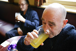 Man and women having a drink in the pub,