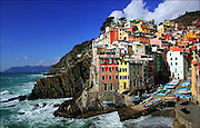 SHOT 3/1/2006 - The town of Riomaggiore in Cinque Terre, Italy. Riomaggiore (Rimasùu in the local language) is a village and a commune in the province of La Spezia, situated in a small valley in the Liguria region of Italy. It is the first of the Cinque Terre one meets coming from La Spezia. Riomaggiore, the first city of the Cinque Terre.<br /> The village, dating from the early thirteenth century, is known for its historic character and its wine, produced by the town's vineyards. Riomaggiore is in the Riviera di Levante region and has shoreline on the Mediterranean's Gulf of Genoa, with a small beach and a wharf framed by tower houses. Riomaggiore has one or two roads where people go and hang out, but most of the life at night can be found at the Bar Centrale.<br /> The Via dell'Amore is a path connecting Riomaggiore to its frazione Manarola, also part of the Cinque Terre.<br /> Riomaggiore is the most southern village of the five Cinque Terre, all connected by trail. The water and mountainside have been declared national parks.<br /> (MARC PISCOTTY/ © 2006)