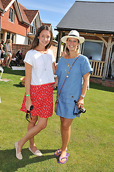 Left to right, INDIA LANGTON and LISA CARTER at a cricket match to in aid of CARE - Corfu Animal Rescue Establishment held at Hawkley Cricket Club, Hawkley, Hampshire on 8th September 2012.