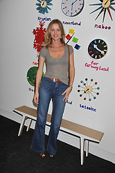 EVA HERZIGOVA at a party to celebrate the opening of Purple Dragon - A new family members club at Grosvenor Waterside, 30 Gatliff Road, London SW1 on 29th September 2011.