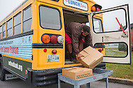 The Lunch Express is a meals on wheels program sponsored by the Second Harvest Food Bank that delivers more than 9,000 backpack meals for children each month.  Winston unloads meals at a local school.