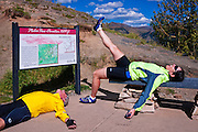Cyclists goofing off on Molas Pass, San Juan Skyway (Highway 550), San Juan National Forest, Colorado