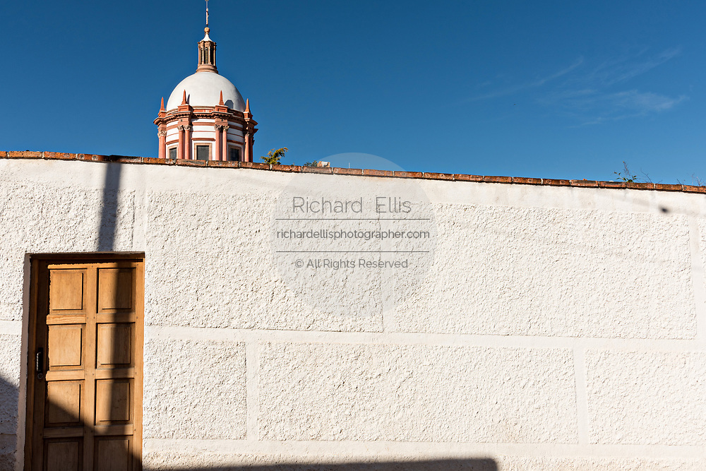 A restored building and wall in the ghost town of Mineral de Pozos, Guanajuato, Mexico. The town, once a major silver mining center was abandoned and left to ruin but has slowly comeback to life as a bohemian arts community.