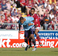 Photo. Leigh Quinnell.  Northampton Town v Southend United Coca Cola league two play off semi final, first round. 15/05/2005. northamptons Lee Williamson holds on to Southends Tes Bramble.
