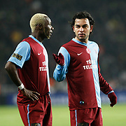 Trabzonspor's Selcuk INAN (R) and Ibrahima YATTARA (L) during their Turkish superleague soccer derby match Fenerbahce between Trabzonspor at the Sukru Saracaoglu stadium in Istanbul Turkey on Sunday 30 January 2011. Photo by TURKPIX