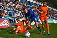 Gillingham FC midfielder Dean Parrett (8) under pressure during the EFL Sky Bet League 1 match between Gillingham and Southend United at the MEMS Priestfield Stadium, Gillingham, England on 13 October 2018.