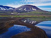 3,500 foot Vent Mountain, a spatter cone within Aniakchak Caldera, reflected in Surprise Lake, Aniakchak National Monument, Alaska.