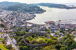 Aerial view from drone of McCaig's Tower and skyline of  Oban, Argyll and Bute, Scotland, UK