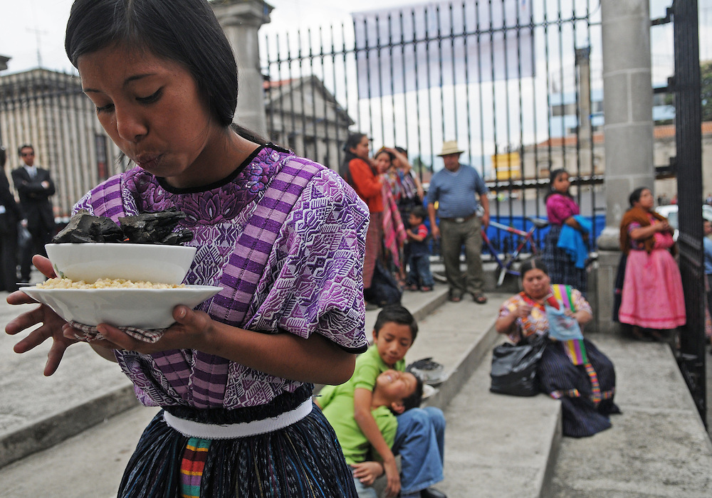 Apr 21, 2011 - Quetzaltenago, Guatemala - A young girl blows on incense to keep the embers alive before the Procession of the Just Judge leaves the Cathedral in Quetzaltenago's central park..(Credit Image: © Josh Bachman/ZUMA Press)