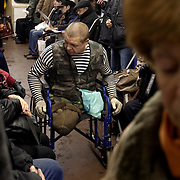 A disabled man begs inside the Moscow metro on the ring line. .The Moscow Metro, which spans almost the entire Russian capital, is the world's second most heavily used metro system after the Tokyo's twin subway. Opened in 1935, it is well known for the ornate design of many of its stations, which contain outstanding examples of socialist realist art.