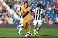 Erik Lamela of Tottenham Hotspur makes a break.  Premier league match, West Bromwich Albion v Tottenham Hotspur at the Hawthorns stadium in West Bromwich, Midlands on Saturday 15th October 2016. pic by Andrew Orchard, Andrew Orchard sports photography.