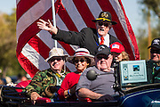 """11 NOVEMBER 2013 - PHOENIX, AZ: Veterans ride in the Phoenix Veterans Day Parade. The Phoenix Veterans Day Parade is one of the largest in the United States. Thousands of people line the 3.5 mile parade route and more than 85 units participate in the parade. The theme of this year's parade is """"saluting America's veterans.""""    PHOTO BY JACK KURTZ"""